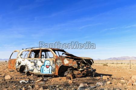 namibia car wreck at gravel road