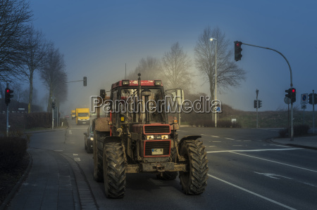 germany grevenbroich tractor and car driving