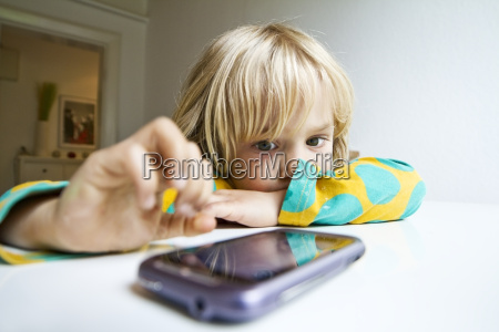 germany kiel girl playing with smartphone