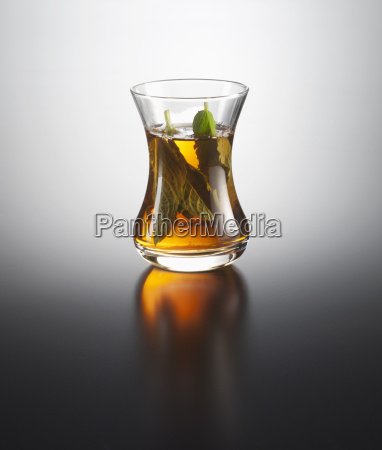 peppermint tea on coloured background close