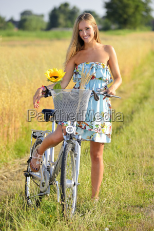 young woman on bicycle tour in