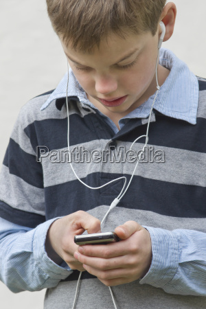 boy using mobile phone with headphones