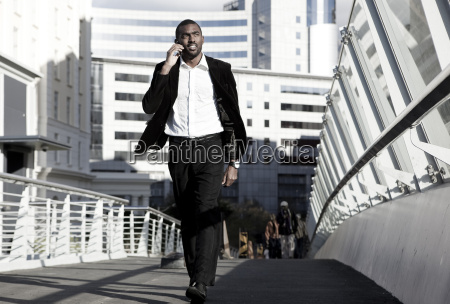 southafrica young african business man walking