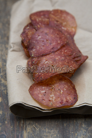 salami in sliced on wooden table