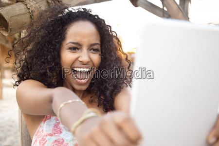 happy young woman outdoors taking selfie