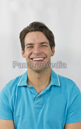 portrait of mid adult man smiling