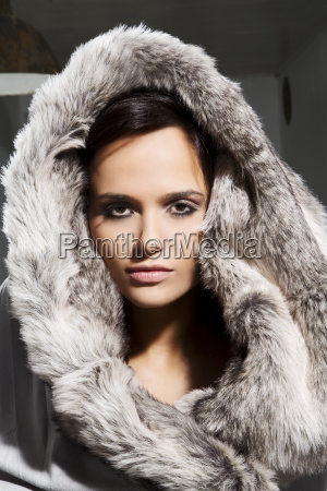 portrait of young woman in fur