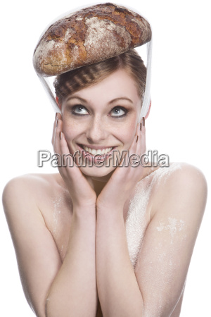 young woman with bread hat against