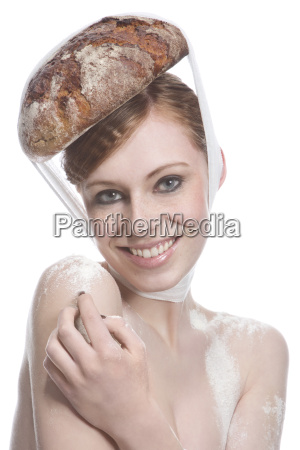 portrait of young woman with bread