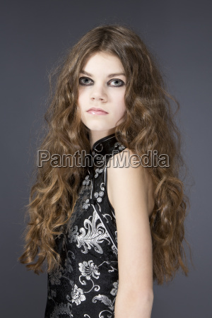 portrait of teenage girl wearing elegant