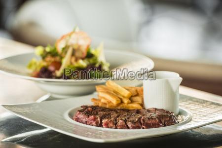 medium rare steak with french fries