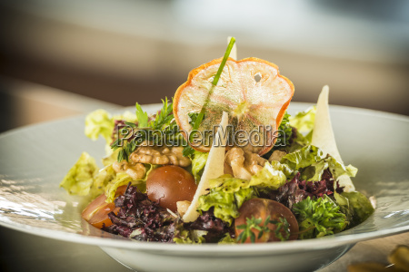 plate of mixed salad with walnuts