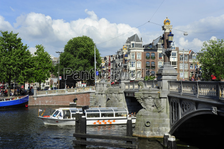 netherlands amsterdam view of excursion boat