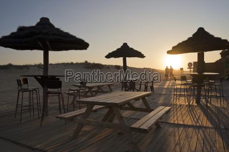 cafe sonnenuntergang strand abend abendrot regenschirm