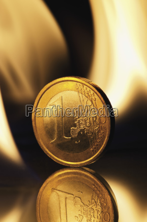 one euro coin burning