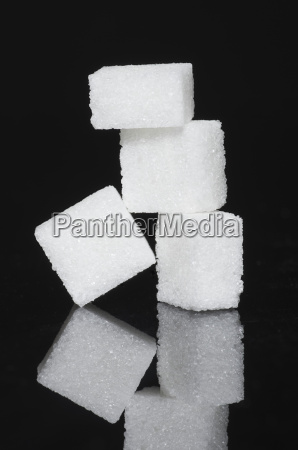 stack of sugar cubes on black
