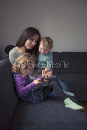 young mother sitting with her little