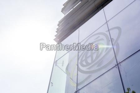 poland warsaw logo at glass facade