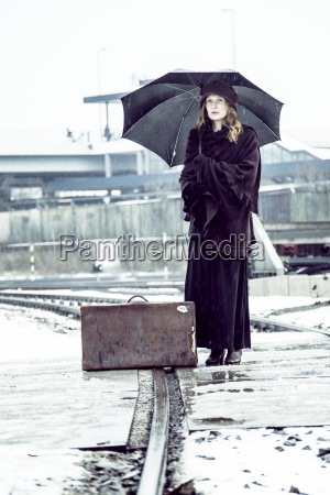germany berlin woman with umbrella and