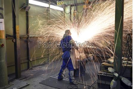 germany saxony worker deburring cast piece