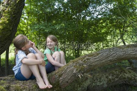 germany bavaria two girls sitting on