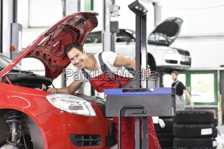 car mechanic working in repair garage
