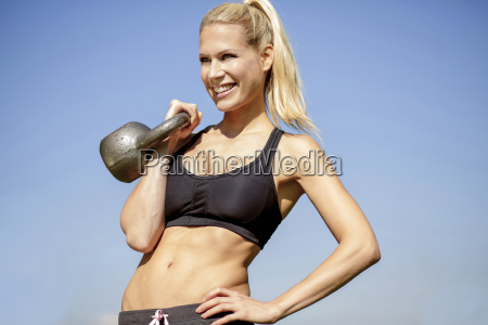 germany young athletic woman with kettlebell