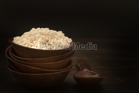bowl of basmati rice with wooden