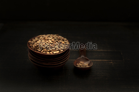 bowl of lentils with wooden spoon