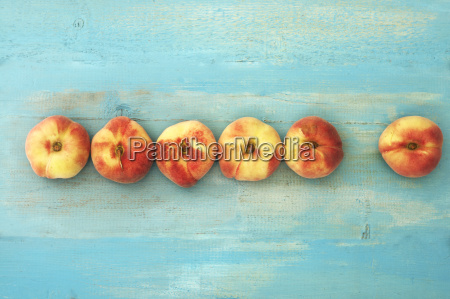 peaches on wooden table close up
