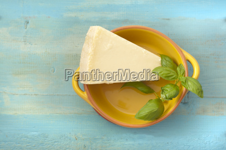 bowl of parmesan cheese with basil