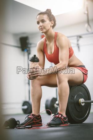 woman in gym taking a break