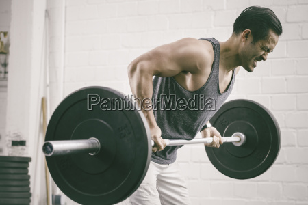 man in gym lifting weights