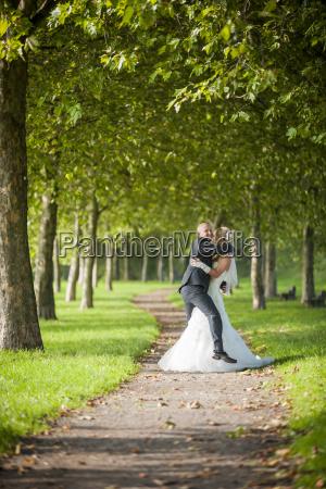 germany rhineland palatinate bridal couple hugging