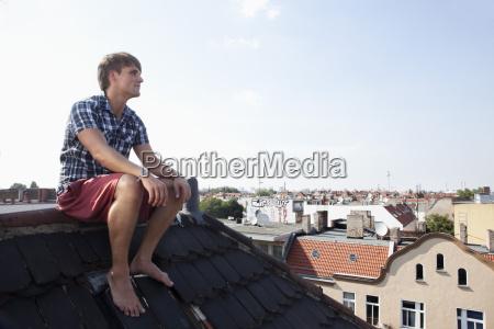 germany berlin man sitting on roof