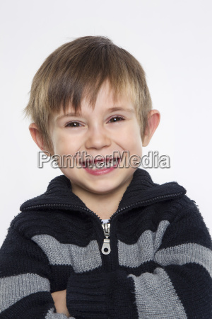 portrait of boy against white background