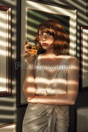 woman having a drink in a