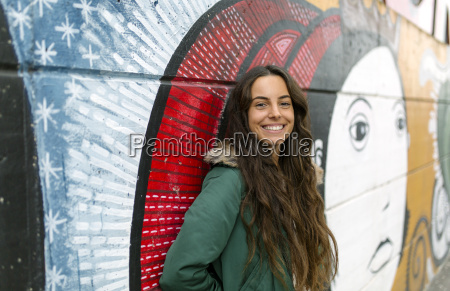 portrait of smiling young woman at