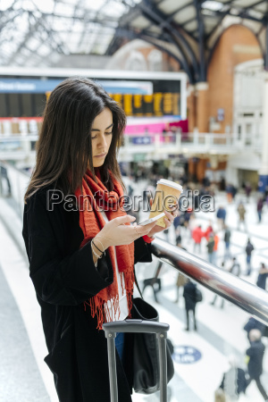 uk london young woman using mobile