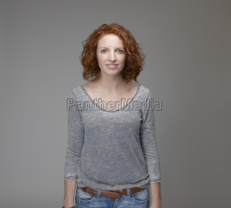 portrait of smiling redheaded woman