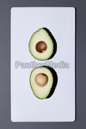 two halves of an avocado on