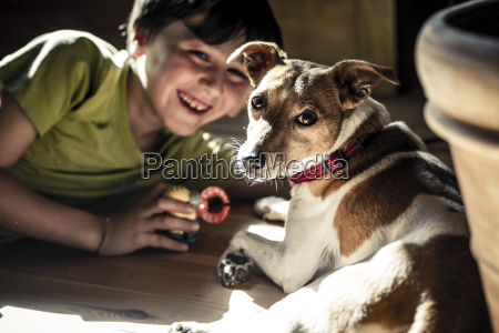 germany boy playing with dog
