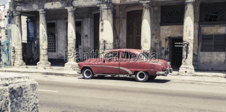 cuba red vintage car parking in