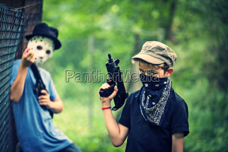 two masked boys playing with toy