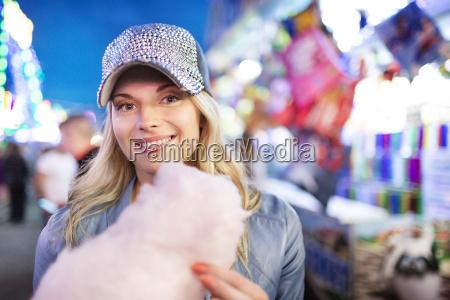 young woman at fun fair eating