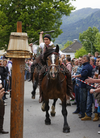 austria carinthia people celebrating kufenstechen festival