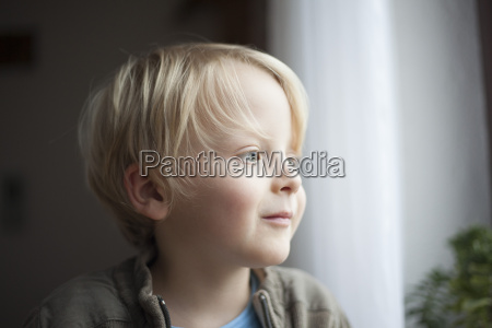 portrait of smiling little boy waiting