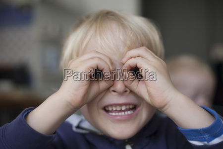 portrait of smiling little boy looking