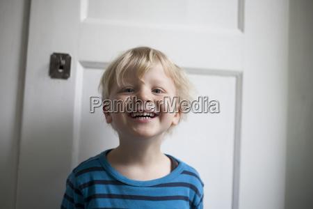 portrait of laughing little boy in