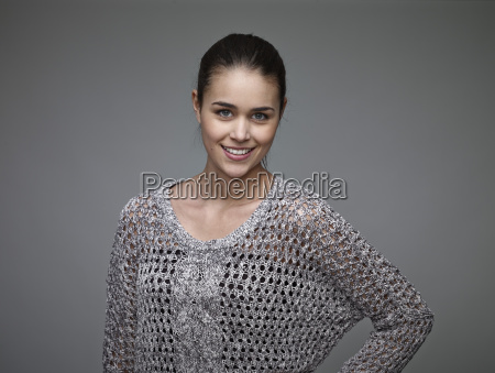 portrait of smiling young woman wearing